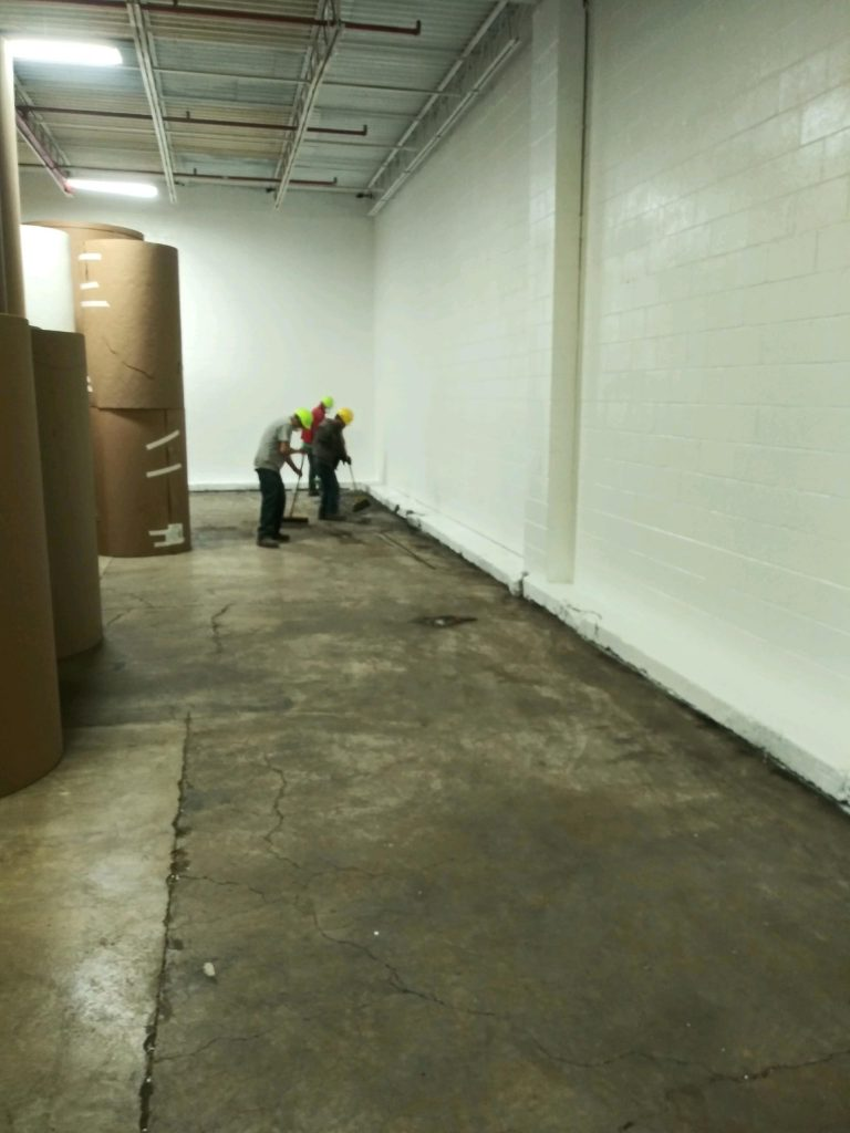 Cleaned and freshly painted white industrial wall - from floor to ceiling | Mid Atlantic Project