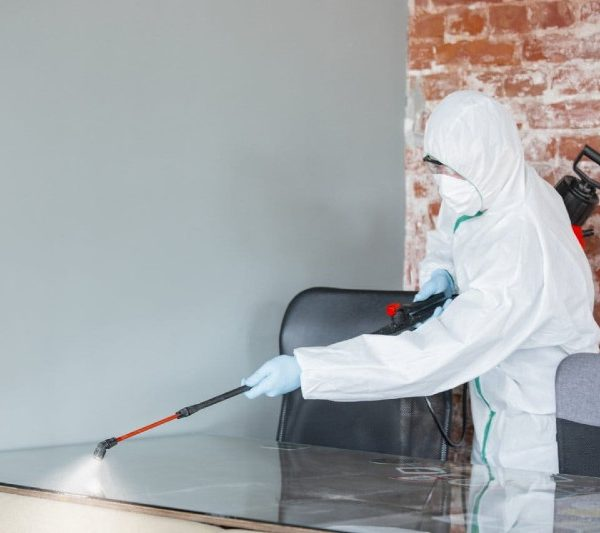 disinfecting surface at a commercial site